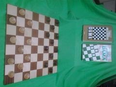 Set completo di Damiera e pedine in legno massiccio e pregiato con due libri sul gioco della dama.