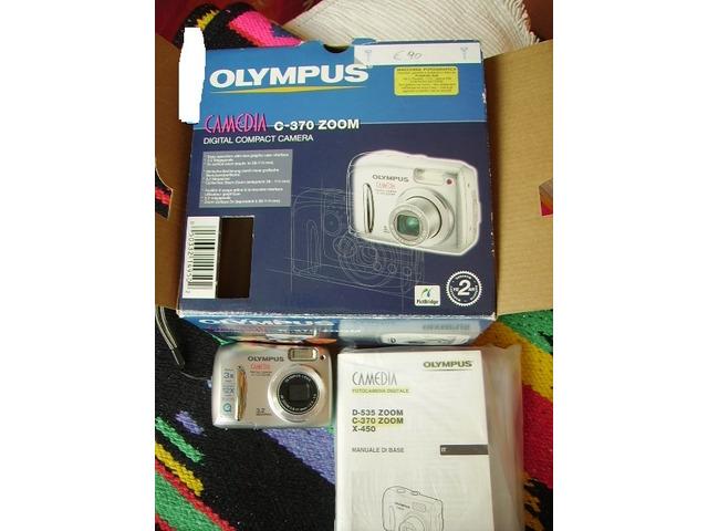 "Fotocamera digitale ""Olympus - 1/2"